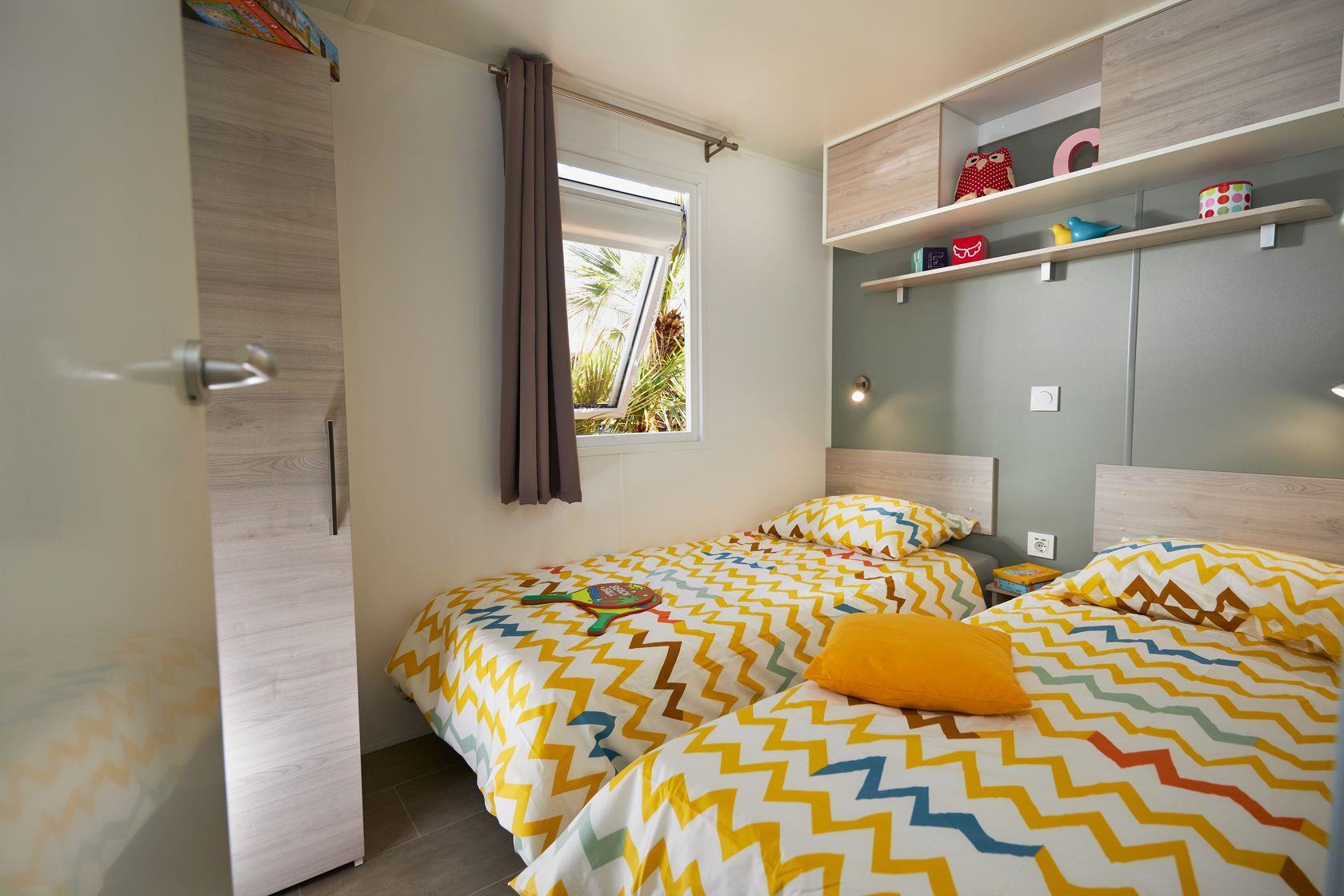 Camping-monte-ortu-nouvelle maison mobile vue mer-chambre é coucher2